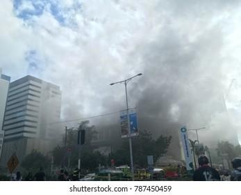 CEBU CITY-JANUARY 6, 2018: A thick black smoke billowing from Ayala Center Cebu Mall as fire continues to rage inside.
