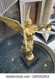 Cebu, Philippines; December 16, 2019: A golden angel statue at the Temple of Leah, a Greco-Roman inspired stone structure in the outskirts of Cebu City dedicated to a businessman's late wife.