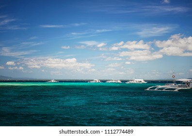 Cebu, Philippines - February 25, 2015: Divers at diving boat at Cebu Island, Philippines.Aerial view of beautiful clear sea water of the Cebu island with diving boats in the background