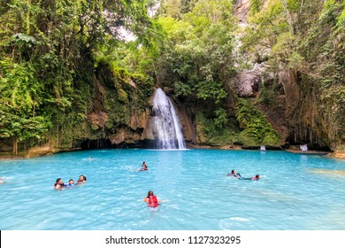 Cebu, Philippines - June 18, 2018: People Swimming In Kawasan Falls in Cebu
