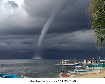 Cebu / Philippines - June 2018: A waterspout off the beach in Malapascua