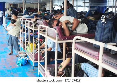 CEBU, PHILIPPINES -  MAY 17, 2012: People sleeping in the ferry as they waiting for arrival . There are 3,219 km of waterways in Philippines.