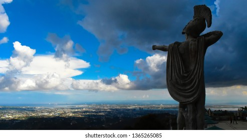 Cebu / Philippines - October 19 2018: Statue of a solder pointing in direction of Cebu city in pose of an archer on premises of Temple of Leah in Cebu Philippines.