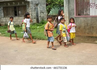 Cebu, Philippines - September 29, 2014. Children walking on the street. Everyday life of filipinos