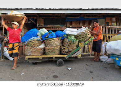 Cebu, Philippines-October 18, 2016: Filipino porters unload sacks from a trolley-Carbon Market oldest and largest farmer's market in town-named for the depot where coal was unloaded from the railroad.