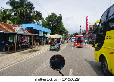Cebu,Philippines - October 30,2017 : Transportation by bus,mini van,motorcycle,bicycle and traditional taxi or tuk tuk in Moalboal, Cebu,Philippines