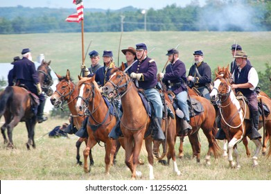 CEDAR CREEK, VA - AUGUST 4: Cavalry soldiers reenacting the 150th anniversary of civil war Battle of 2nd Manassas on August 4, 2012 at Cedar Creek Battlefield, Virginia.