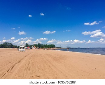 Cedar Grove Beach in Staten Island, New York with empty lifeguard seat on a sunny day.
