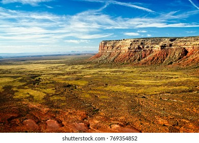 Cedar Mesa cliffs atop Moki Dugway overlooking nearby Valley of the Gods in Utah's canyonlands.