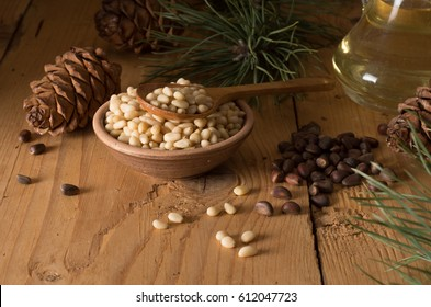Cedar nuts and cones on wooden table