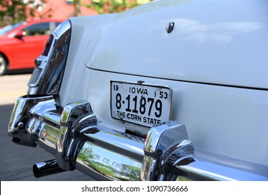 """Cedar Rapids, Iowa, May 2018 - A white antique Cadillac proudly displays its Iowa license plate reading """"The Corn State."""""""