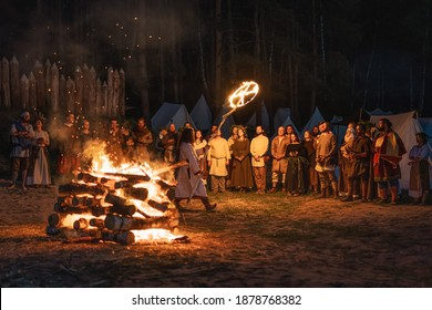Cedynia Poland June 2019 Pagan reenactment of Kupala Night, called in Poland Noc Kupaly, shaman blessing believers with burning sign of sun. Slavic holiday celebrated on the shortest night of the year
