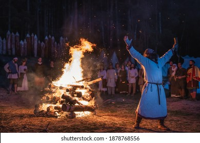 Cedynia, Poland, June 2019 Pagan reenactment of Kupala Night, called in Poland Noc Kupaly, shaman praying to old gods for their blessing. Slavic holiday celebrated on the shortest night of the year
