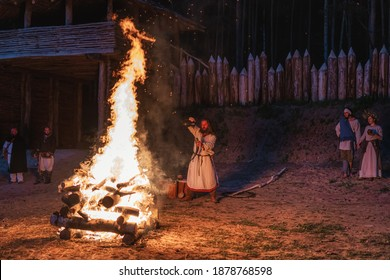 Cedynia, Poland, June 2019 Pagan reenactment of Kupala Night, called in Poland Noc Kupaly, shaman pouring wine to drinking horn. Slavic holiday celebrated on the shortest night of the year