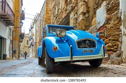 Cefalu, Italy - March 19, 2019: French vintage car Citroen 2CV parked in the street
