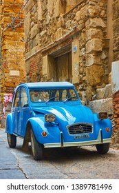 Cefalu, Italy - March 19, 2019: French oldtimer classic car Citroen 2CV parked in the old street
