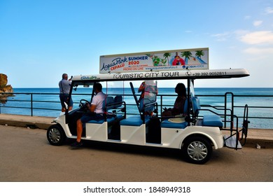 CEFALU ITALY SEPTEMBER 19  tourists on sightseeing tour with electric car guide Sep 19 2020 Cefalù Italy