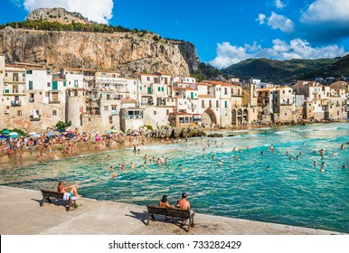 CEFALU, SICILY - AUGUST.12. 2017: People on beautiful beach at the bay in Cefalu, Sicily.Cefalu is very popular touristic old town in Sicily.