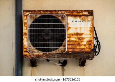 CEFALU, SICILY - FEBRUARY 11, 2020: The old and rusty air conditioning unit of the FanAir company on a wall