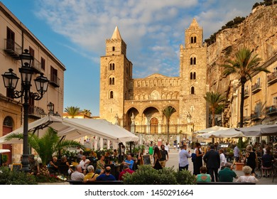 CEFALU, SICILY, ITALY - June 26, 2019: Cathedral Square (Piazza del Duomo) - Central Square or Main Street in Cefalu with bars and restaurants. Central element of square is Cefalu cathedral.