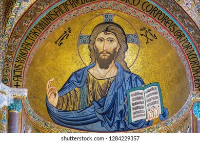 CEFALU, SICILY, ITALY - NOVEMBER 16, 2018: The Christ Pantocrator mosaic in Cathedral San Salvatore