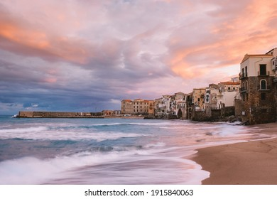 Cefalu Sicily, sunset at the beach of Cefalu Sicilia Italy, mid-age men and woman on vacation Sicily.