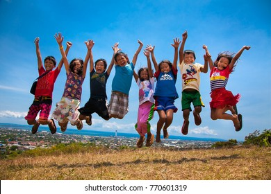 CEGU, PHILIPPINES-MARCH 25, 2016: Local children are jumping in Cebu city on March 20, 2016.  Philippines.