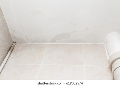 Ceiling in the bathroom damaged by flooding