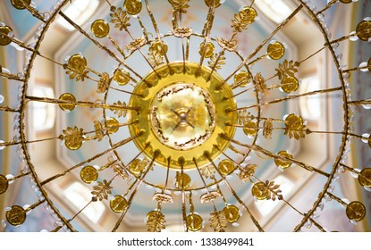 ceiling in the church with the illuminator. church lamp look from below