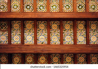 Ceiling coffered of two azulejos per wooden board (dos por tabla) and wooden beams seen from below, century XVI, Cartuja of Seville, Andalusia, Spain