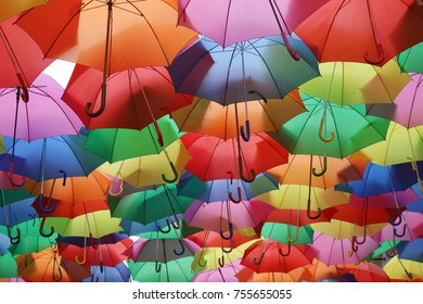Ceiling of colorful umbrellas over a street