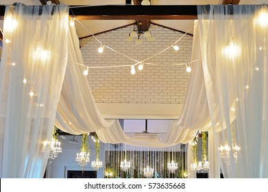 Ceiling Decor with tulle and eclectic chandeliers