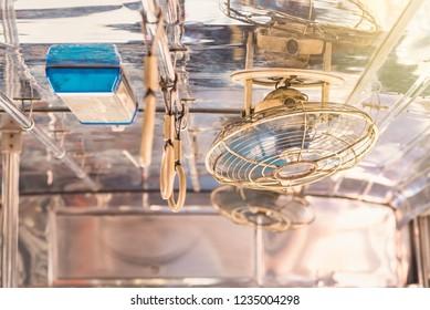 Ceiling fan on the bus.Blue ceiling fan.Bangkok, Thailand