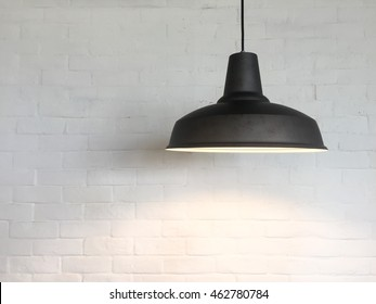 The Ceiling Fixture on brick wall background.