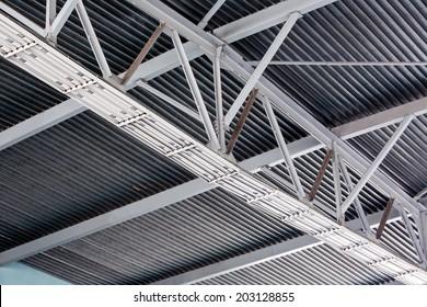 Ceiling fragment of metal roof of industrial building