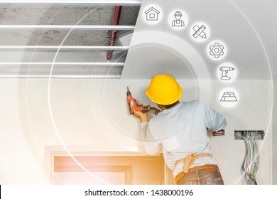 Ceiling installation with expert technicians In the room that is in the construction process. And the working diagram with graphic symbols.