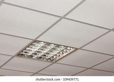 Ceiling lamp built-in on the white ceiling close-up diagonal view