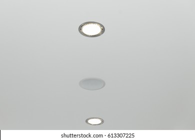 Ceiling and lighting inside office building. Ceiling light closeup.