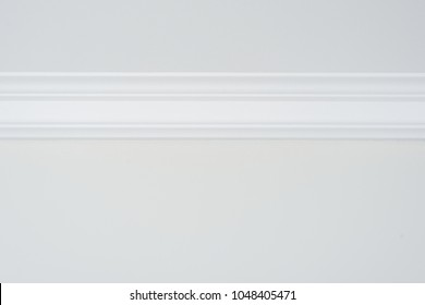 Ceiling moldings in the interior, detail of a flat ceiling skirting