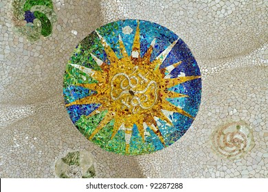 Ceiling with mosaic sun at Guell Park, Barcelona, Spain.