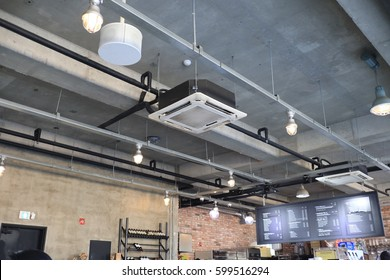 Ceiling mounted air conditioner in cafe