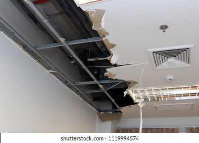 Ceiling panels damaged hole in the roof of house from drain pipes water leakage. House or office building problem from plumber system. Service and repair concept.