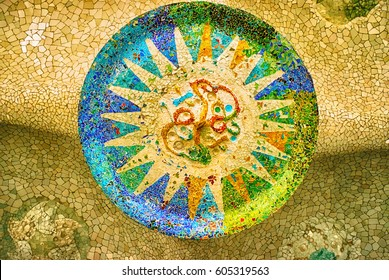 Ceiling with a sun mosaic at the Park Guell designed by Antoni Gaudi, Barcelona, Spain.
