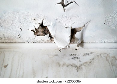 Ceiling and wall with rain damage due to violent weather and roof damage
