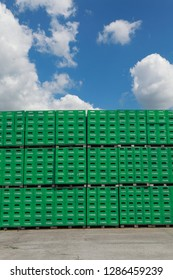 CELAREVO, SERBIA - JUNE 11. 2017. Carlsberg Serbia brewery, heap of green crates for Tuborg beer  at large warehouse in factory, with blue sky and clouds