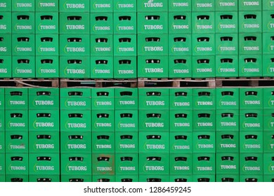 CELAREVO, SERBIA - JUNE 11. 2017. Carlsberg Serbia brewery, heap of green crates for Tuborg beer at factory large warehouse