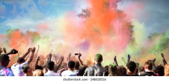 Celebrants dancing during the color Holi Festival