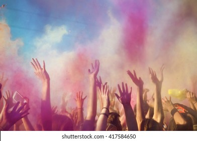 Celebrants dancing during the color Holi Festival . Party, Social Event, Holi, Colors, Multi Colored, Group Of People