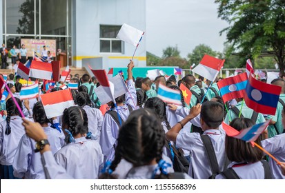 Celebrate ASEAN Day falls on Aug. 8,Students hand holding carry the flag of of the Association of Southeast Asian Nations,Celebrating 46 years of ASEAN