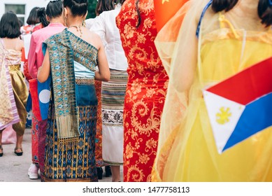 Celebrate ASEAN Day falls on Aug. 8,Students hand holding carry the flag of of the Association of Southeast Asian Nations,Celebrating 47 years of ASEAN